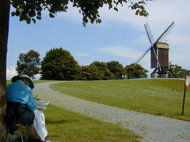 Woman painting the windmill