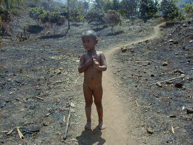 Small boy on his way to bathe in nearby stream